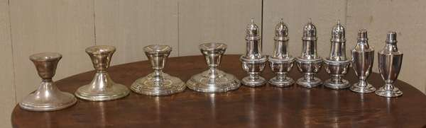 Weighted sterling lot, salt & peppers and candlesticks (77-198)