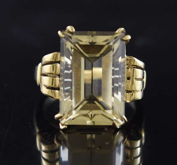 Jewelry - 14kt yellow gold ring set with approx. 15 ct. emerald cut citrine, sz. 7 1/4, 9.0 grams.(875-47)