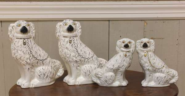 "Two pairs of Staffordshire Spaniels, 9""H. and 10"" (918-15)"
