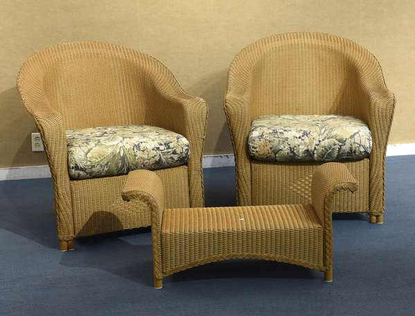 Pair of wicker chairs with foot stool, Lloyd Flanders (487-7)