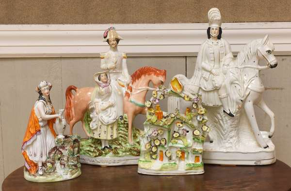 Four pieces of Staffordshire inc horse with rider, blossoms, other horse with rider, various sizes (918-21)