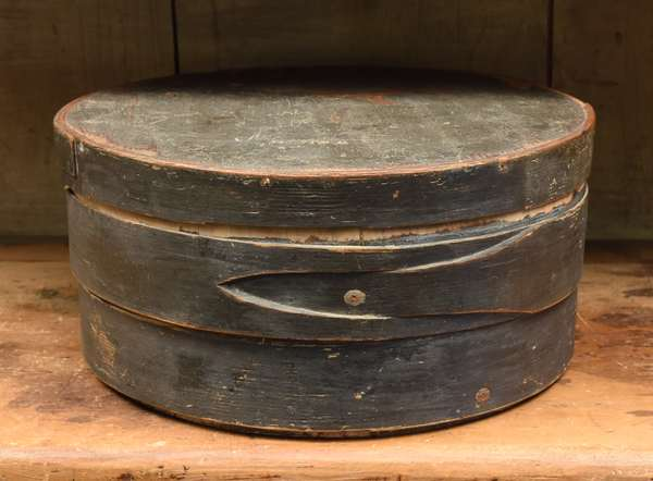 """19th C. circular covered storage box with lapped construction in old blue/grey paint, signed W Winch, 14""""D."""