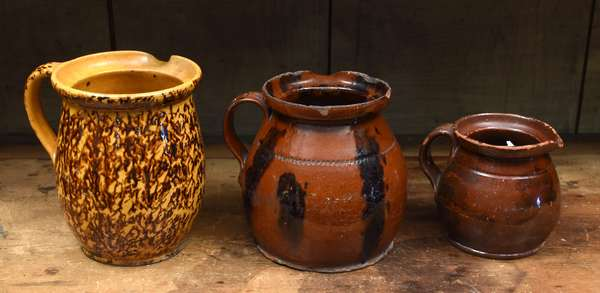"""Three 19th C. redware handled pouring pitchers, 4.5"""" to 7"""""""