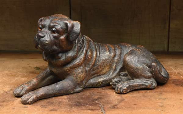 """Antique painted clay dog with glass eyes, 15""""L. x 7.5""""H."""