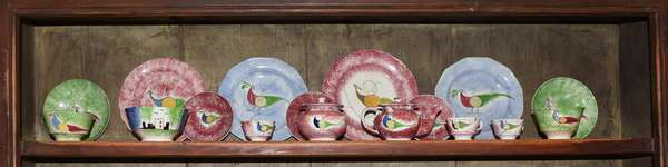 Collection of 19th C. PA peafowl spatterware, 17 pieces