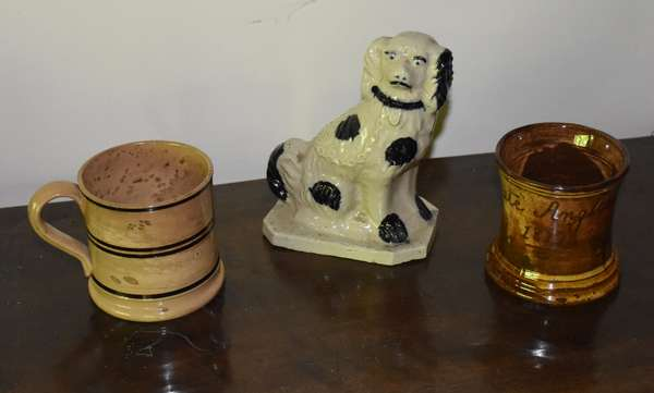 Earthenware spaniel dog with two redware mugs