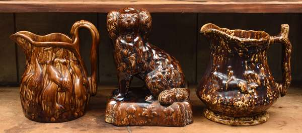 """19th C. Bennington type spaniel with two pouring pitchers, 11"""" and 10""""H."""
