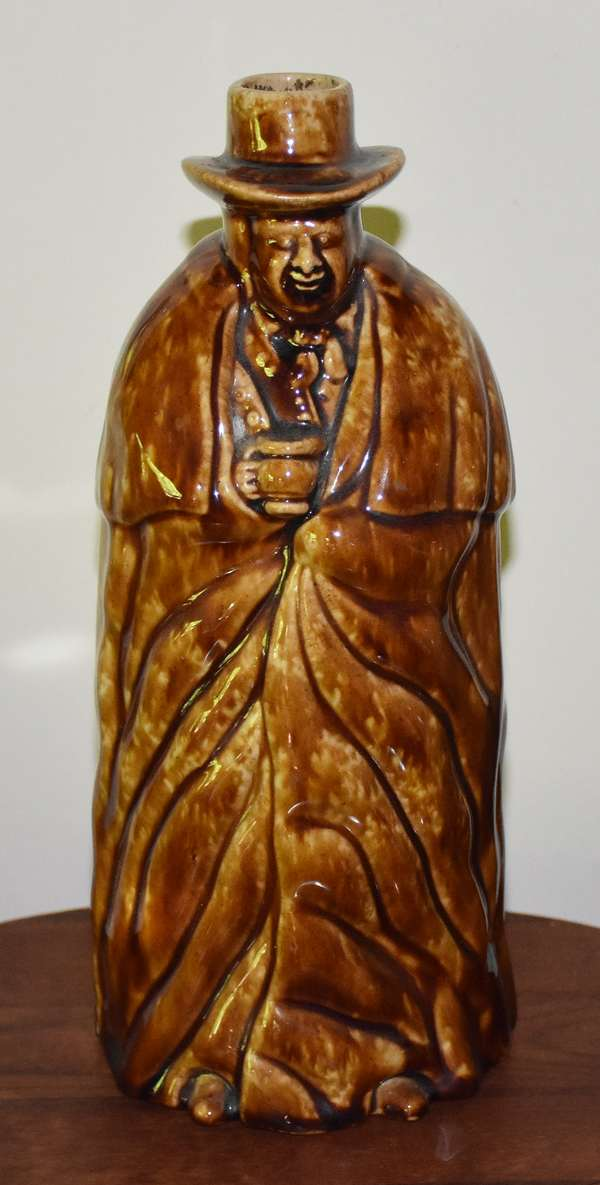"""Bennington coachman bottle signed and dated 1849, 10.5""""H."""