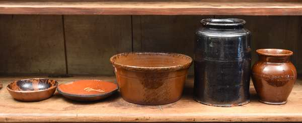 Five pieces of 19th C. slip decorated redware