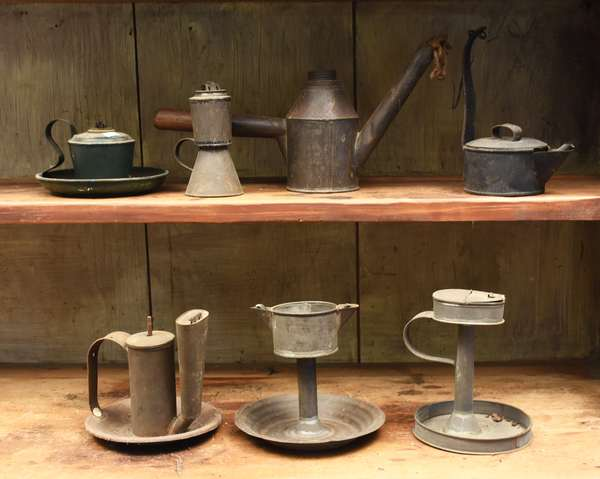 Seven early tin lighting devices