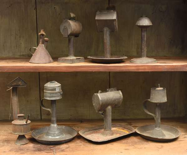 Eight early tin lighting devices