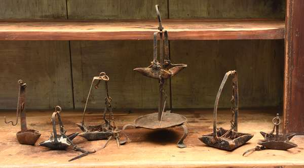 Six early iron grease lamps