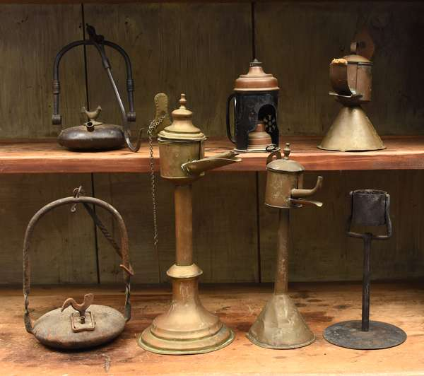Seven early brass and iron lighting implements