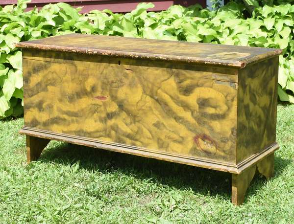 """Early 19th C. blanket box smoke paint decorated in old green/black paint, 24""""H. x 42""""L."""