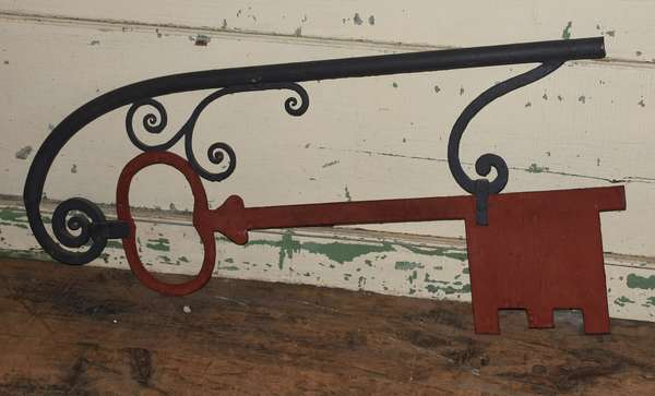 """Antique iron key trade sign painted black and red, 22""""h. x 45""""L."""