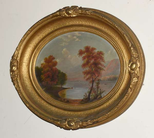 """19th C. American school oil on canvas, Autumn river landscape with cows, oval frame, dimensions of image 11"""" x 14"""""""