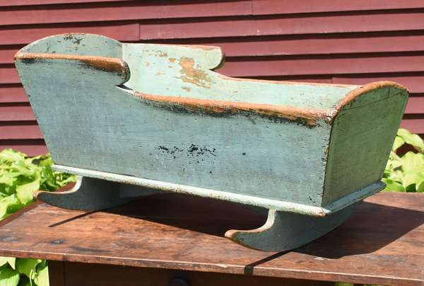 """Well made early 19th C. cradle in old blue paint, 38""""L. x 19""""H."""