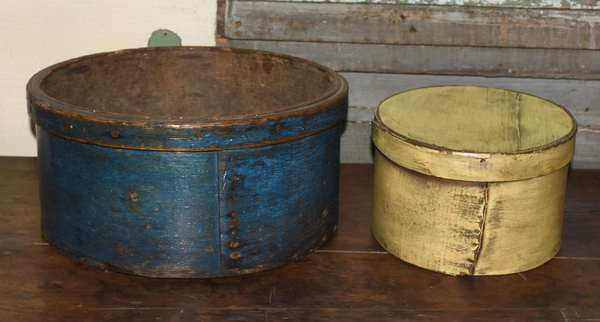"""19th C. circular storage bowl in old blue paint, 15""""D. x 17""""H. along with a yellow painted pantry box"""