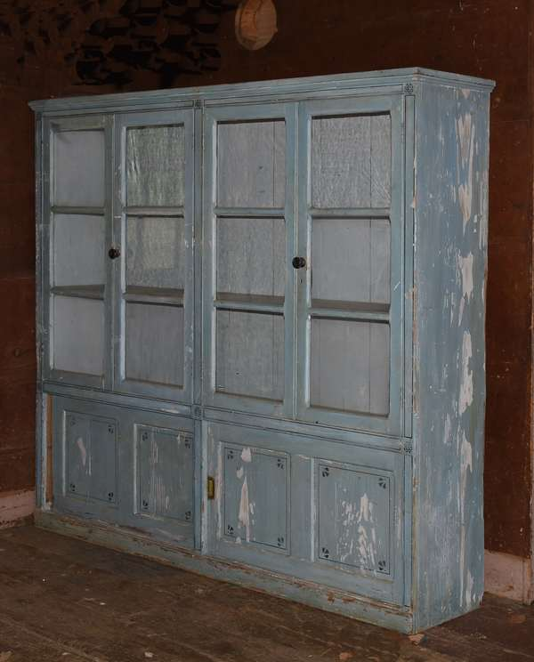 """Large blue painted country cabinet with four glass doors above and sliding doors below, 73""""W. x 67""""H. x 14""""D."""