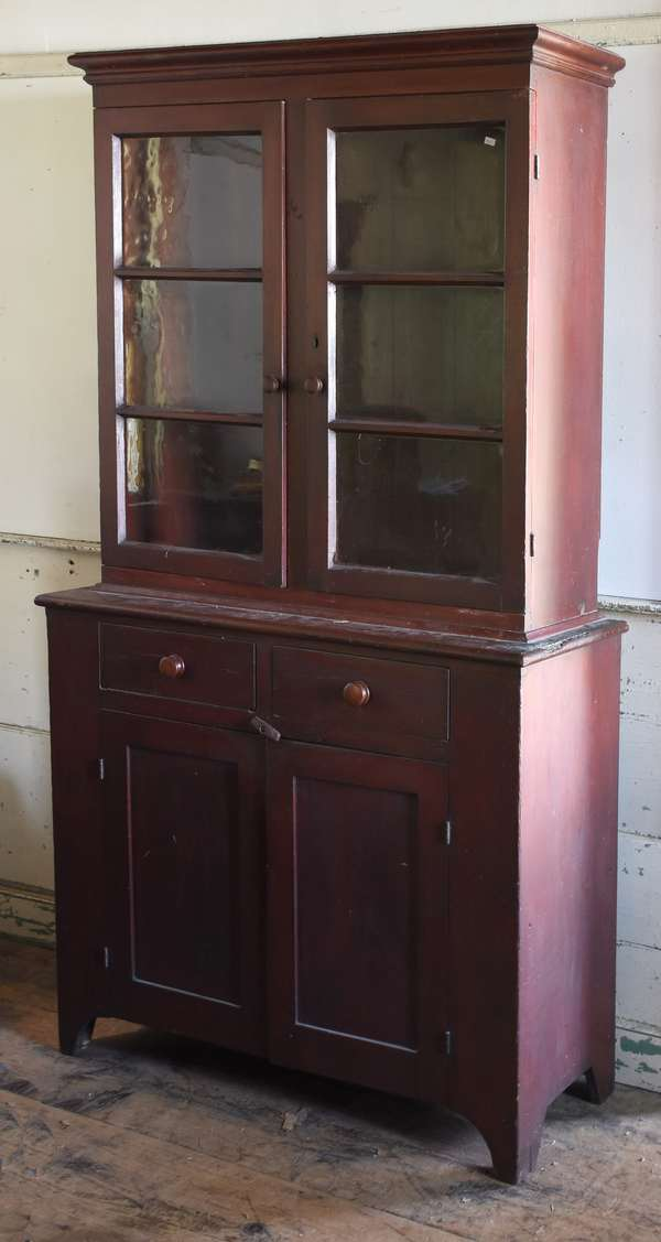 Early 19th C. two-part setback glass door country cupboard, cut-out base in old paint