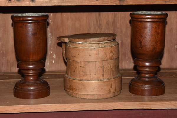 """Three early wooden items: pair of treenware cups with lead inserts, 9""""H., with a lidded and lapped wooden tankard, 6.5""""h."""