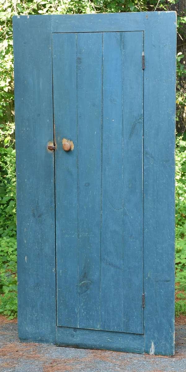 """Unusual country one-door corner cupboard in blue paint, 78.5""""H. x 42""""W. x 17""""D."""