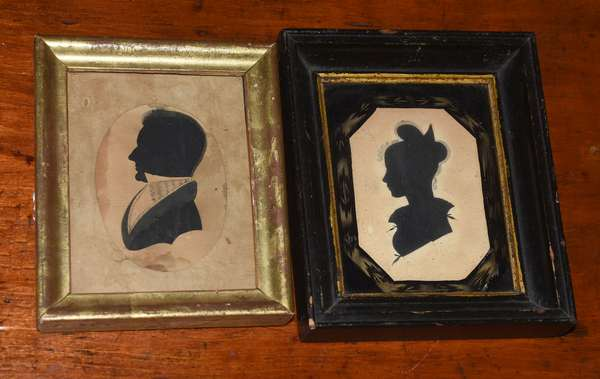 """Two early silhouettes, gentleman 4"""" x 3"""", with a lady, 4.25"""" x 3"""" with reverse painted framing"""