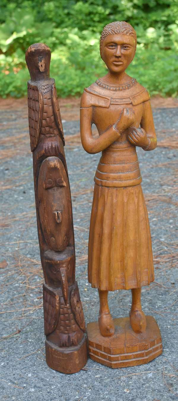 """Two early wood carvings: small early totem pole, 17""""H., with a sculpture of a Dutch woman, 18""""H."""