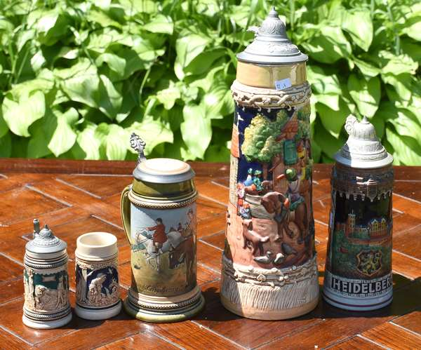 """Group of five German steins including Mettlach, heights from 4"""" to 15.5"""" (12-4)"""