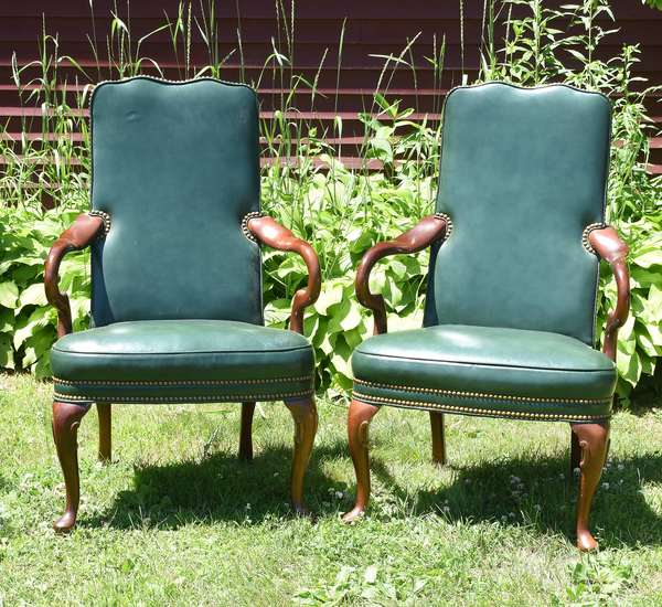Pair of green leather lolling chairs, Hancock & Moore (696-26)
