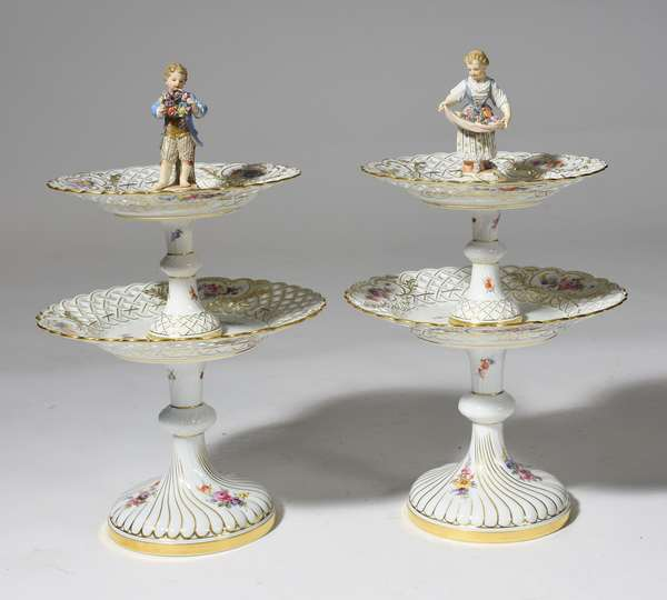 "Pair of 19th C. Meissen two-tier reticulated cake stands, with hand-painted decoration, and boy and girl finials, 15.5""H."