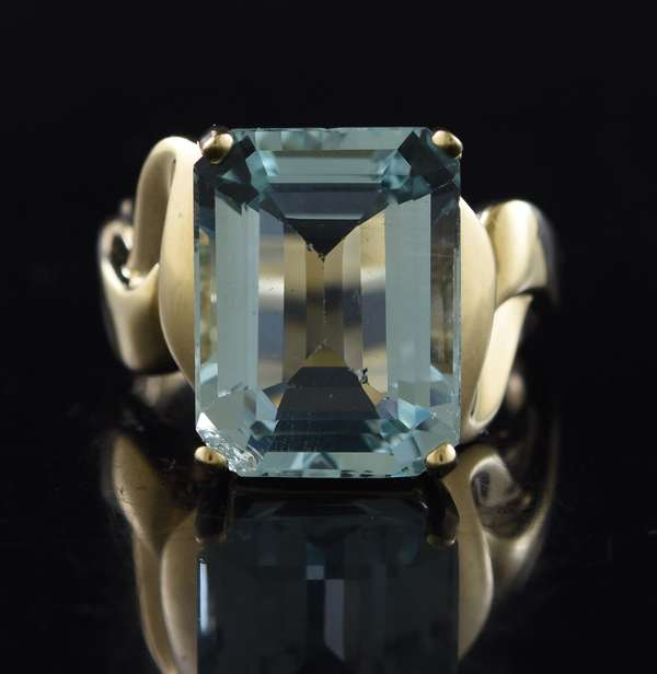 Jewelry: 14k yellow gold ring set with an emerald cut aquamarine measuring 11.9 mm x 15.6 mm, 9.6 grams