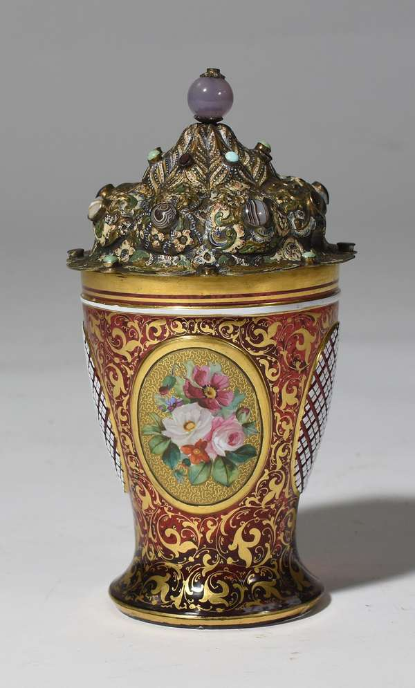 "Red Moser glass jar with gilding and hand-painted floral plaques, with silver jeweled lid with lion roundels, 7.5""H."