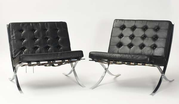 "Fine pair of black leather and chrome Barcelona chairs, ca. 1960's, 29""W. x 28""H. overall, 13.5"" seat height"