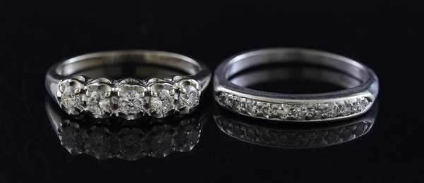 Jewelry: Two diamond bands, one in platinum other in 14k white gold, size 7