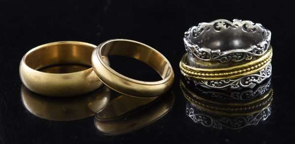 Jewelry: two 14k yellow gold wedding bands, size 11.5 and 9, - 16 grams total, with a 3rd silver and gold band, size 10.5
