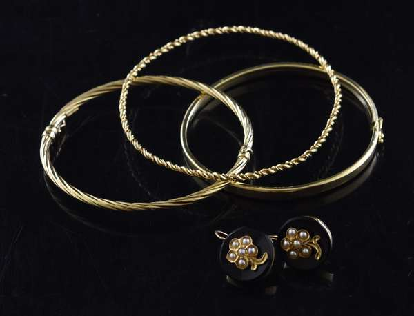 Jewelry: Pair of Victorian gold earrings with three gold bracelets