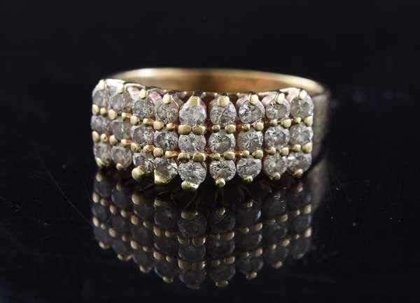 Jewelry: Multi-stone diamond band set in 14k yellow gold, size 8