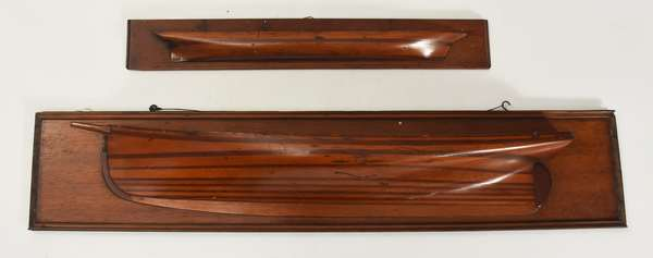 "Two early wooden ship's half hulls, 8.5""H. x 42""L., and 4""H. x 27""L."