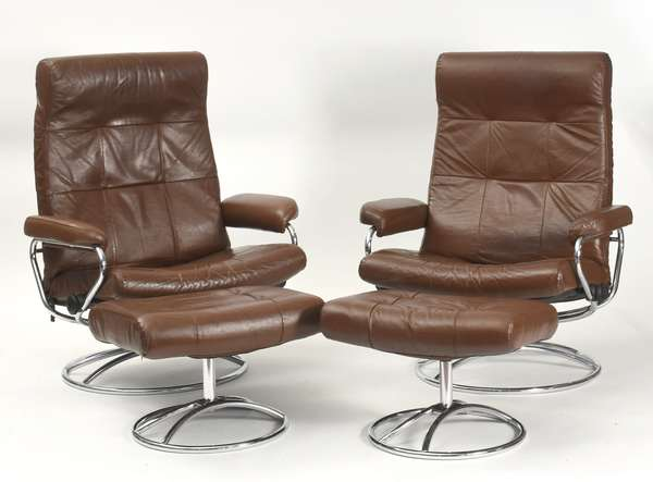 "Pair of brown leather and chrome Ekornes Stressless lounge chairs with ottomans, 25""W. x 39""H."