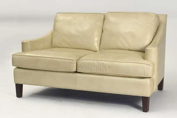 "Designer Lillian August cream-colored leather loveseat, 59""L."