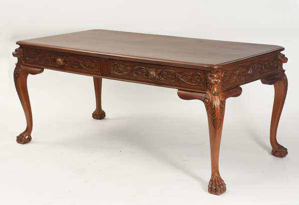 "Victorian writing desk with two drawers and carved lion decoration, possibly Horner, 72""L. x 30""H. x 35""D."