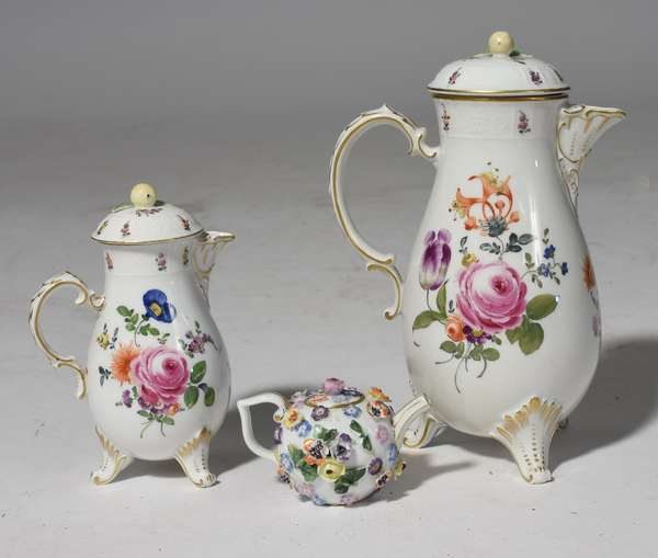 "Three porcelain tea pots: two Dresden teapots, 6"", 9""H., with small Meissen teapot, 2.5""H."