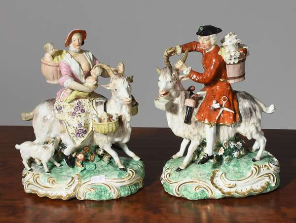 "Pair of 19th C. European porcelain figures on goats, 10""H."