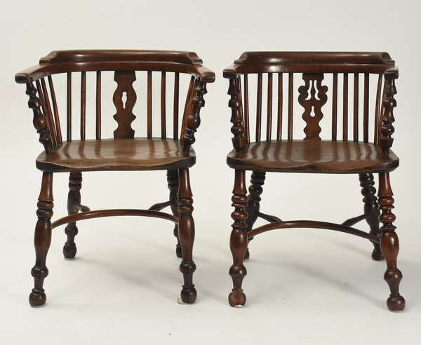 "Good assembled set of seven 19th C. English elm and yew wood ""captains"" low back Windsor chairs"