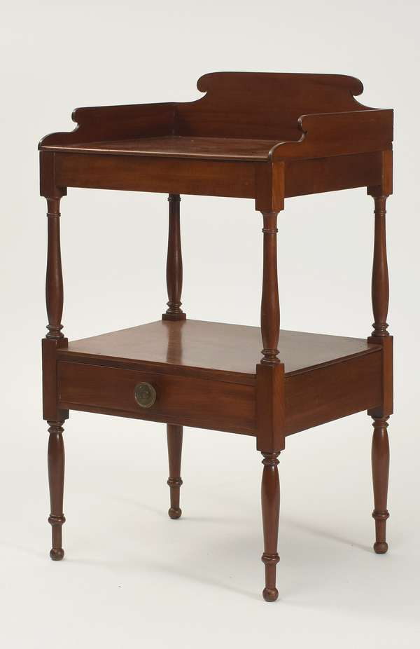 "Sheraton mahogany two tier stand, top with dovetailed gallery, lower shelf containing a dovetailed drawer, ca.1820, 20""W. x 36""H."