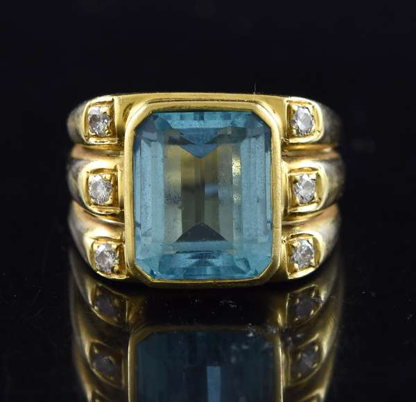 Jewelry: 14k diamond and blue topaz ring, 11 grams, size 7.5