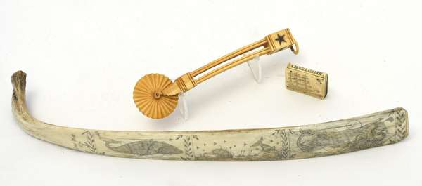 """Three pieces of 19th C. scrimshaw; tortoiseshell inlaid pie crimper, 7""""L., whale bone carved with whale motifs and signed Suna 1860, 16""""L., with a match safe, 1.75""""L., with ship and basket of flowers decoration"""