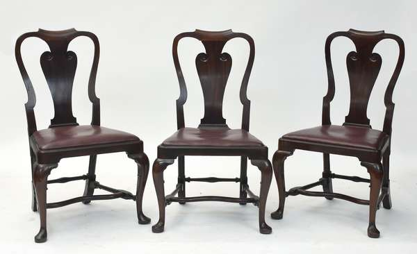 """Three 18th C. Queen Anne mahogany side chairs with stretcher base and maroon leather upholstery, likely RI, 17"""" seat height, 38.5"""" overall"""