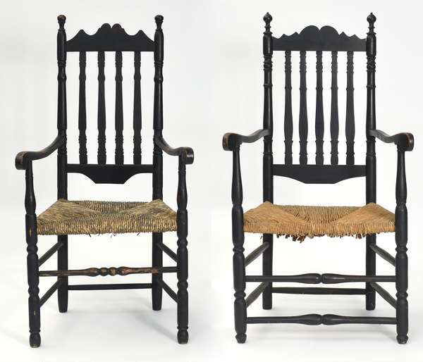 """Two bannister back armchairs in black paint with double tombstone crests and rush seats, 17.5"""" seat, 46.5"""" overall; 16.5"""" seat, 45.5"""" overall"""